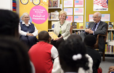 Mrs. Lynne Cheney speaks to students from Ambassador Baptist Christian School, Wednesday, July 11, 2007, at the Anacostia Interim Public Library in Washington, D.C. During Mrs. Cheney's visit the National Endowment for the Humanities announced that all D.C. public libraries will receive this year's We the People Bookshelf, a collection of classic books with themes related to American ideas and ideals. Seated with Mrs. Cheney are Chief Librarian of the D.C. Public Libraries Ginnie Cooper and Chairman of the National Endowment for the Humanities Bruce Cole. White House photo by David Bohrer.