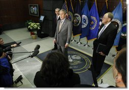 President George W. Bush delivers remarks during his visit to the National Counterterrorism Center Monday, Dec. 8, 2008, in McLean, VA. President Bush is joined by Counterterrorism Director Mike Leiter, left, and National Intelligence Director Mike McConnell. White House photo by Eric Draper