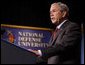 "President George W. Bush delivers remarks Tuesday, Sept. 9, 2008, to the National Defense University's Distinguished Lecture Program. Said the President, ""On this campus you're helping train the next generation of military and civilian leaders who will defend our nation against the real and true threats of the 21st century. I thank you for your patriotism; I thank you for your hard work; and I thank you for your devotion to protecting the American people."" White House photo by Eric Draper"