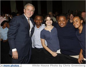 President George W. Bush poses with a group of students Thursday, Jan. 8, 2009, following his address at the General Philip Kearny School in Philadelphia, where President Bush spoke about the success of the No Child Left Behind Act and urged Congress to strenghten and reauthorize the legislation. White House photo by Chris Greenberg