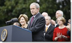 """With Mrs. Laura Bush, the Vice President and Mrs. Cheney and Cabinet secretaries looking on, President George W. Bush addresses his staff Thursday, Nov. 6, 2008, on the South Lawn of the White House. Said the President, """"As we head into this final stretch, I ask you to remain focused on the goals ahead. I will be honored to stand with you at the finish line.""""  White House photo by Eric Draper"""