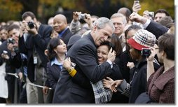 """President George W. Bush embraces an employee of the Executive Office of the President Thursday, Nov. 6, 2008, after delivering remarks to his staff on the upcoming transition. Said the President, """".Over the next 75 days, all of us must ensure that the next President and his team can hit the ground running.'  White House photo by Eric Draper"""