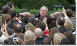 """President George W. Bush reaches out to staff members of the Executive Office of the President Thursday, Nov. 6, 2008, after speaking to them on the upcoming presidential transition. The President was joined by his Cabinet, Vice President and Mrs. Cheney and Mrs. Laura Bush as he told his staff, """"As January 20th draws near, some of you may be anxious about finding a new job, or a new place to live. But between now and then, we must keep our attention on the task at hand -- because the American people expect no less.""""  White House photo by Joyce N. Boghosian"""
