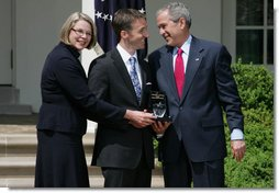 President George W. Bush smiles as he and Secretary of Education Margaret Spellings present Mike Geisen with the 2008 National Teacher of the Year honors Wednesday, April 30, 2008, in the Rose Garden of the White House. White House photo by Shealah Craighead