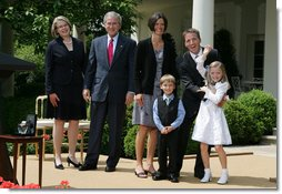 President George W. Bush and Secretary of Education Margaret Spellings join Mike Geisen, the 2008 National Teacher of the Year, and his family as they celebrate the 7th grade teacher's honors Wednesday, April 30, 2008, in the Rose Garden of the White House. Family members include Mr. Geisen's wife, Janet, and their children, Johanna, 8, and Aspen, 6.  White House photo by Joyce N. Boghosian