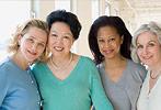 Photo of four women smiling.