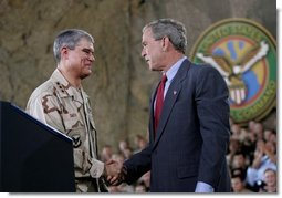 President George W. Bush greets Lieutenant General Lance Smith, Commander Central Command, before delivering remarks to military personnel at MacDill Air Force Base in Tampa, Florida, Wednesday, June 16, 2004.   White House photo by Eric Draper