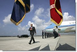 President George W. Bush walks past a military honor guard after arriving aboard Air Force One at MacDill Air Force Base in Tampa, Florida, Wednesday, June 16, 2004.  White House photo by Eric Draper