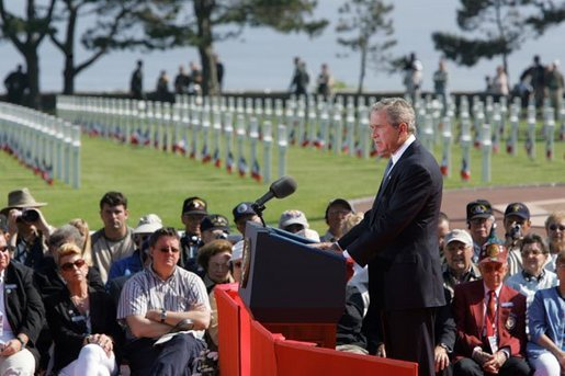 President George W. Bush addresses World War II veterans and families during the 60th anniversary of D-Day at the American Cemetery in Normandy, France, June 6, 2004. White House photo by Paul Morse.