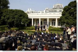 Standing with, from left, Vice President Dick Cheney, Secretary of Health and Human Services Tommy Thompson and Secretary of Homeland Security Tom Ridge, President George W. Bush delivers remarks during the signing ceremony of S.15-Project Bioshield Act of 2004, in the Rose Garden Wednesday, July 21, 2004.  White House photo by Paul Morse