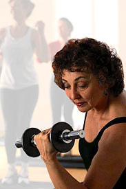 photo of woman lifting weight