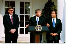 """Announcing the national """"Do Not Call Registry,"""" President George W. Bush stands with Federal Trade Commission Chairman Timothy Muris, left, and Federal Communications Commission Chairman Michael Powell in the Rose Garden Friday, June 28, 2003. The registry protects privacy by blocking incoming telemarketing calls.  White House photo by Susan Sterner"""