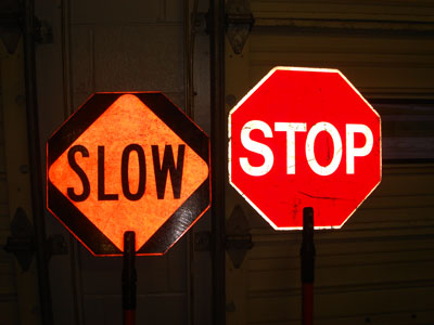 Stop sign and slow sign