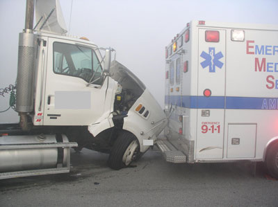 tractor trailer wrecked into ambulance