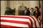 President George W. Bush and Laura Bush pay their respects to Chief Justice William Rehnquist as his body lies in repose in the Great Hall of the U.S. Supreme Court Tuesday, Sept. 6, 2005. Standing as honor guard for the Chief Justice is one of his former law clerks, Courtney Ellwood. White House photo by Eric Draper