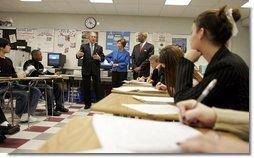 President George W. Bush, Mrs. Laura Bush and Secretary of Education Rod Paige talk to international baccalaureate program students of J.E.B. Stuart High School in Falls Church, VA on January 12, 2005.  White House photo by Paul Morse