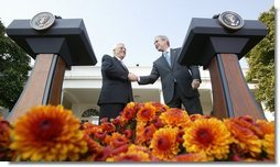 President George W. Bush and President Mahmoud Abbas, of the Palestinian Authority, shake hands after speaking with the media Thursday, Oct. 20, 2005, in the Rose Garden of the White House.  White House photo by Paul Morse