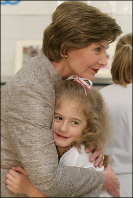 Mrs. Laura Bush receives a farewell hug from a young child at a Boys & Girls Club program Thursday, Feb. 22, 2007 at the D'Iberville Elementary School in D'Iberville, Miss. White House photo by Shealah Craighead