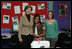 Mrs. Laura Bush embraces 10-year-old Taylor Rice, whose father is currently serving overseas in the Army Reserves, during a visit to the Learning Center at Andrews Air Force Base in Maryland, Wednesday, Dec. 5, 2007, where Mrs. Bush participated is a roundtable discussion on the special needs of military youth and families.