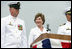 """Mrs. Laura Bush smiles at Master Chief (SS) Mark K. Brooks, Command Master Chief, USS Texas, Saturday, September 9, 2006, after delivering remarks and giving the traditional command: """"Man your ship and bring it to life!"""", during the Commissioning Ceremony in Galveston, Texas. Mrs. Bush participated in the christening of ship on July 31, 2004. White House photo by Shealah Craighead"""