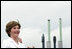 Mrs. Laura Bush, ship sponsor of the USS Texas, applauds at the conclusion of the Commissioning Ceremony Saturday, September 9, 2006, in Galveston, Texas. White House photo by Shealah Craighead