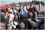 Vice President Dick Cheney and Mrs. Cheneyspeak to members of the mediaduring a recentvisit to the flood ravaged areas of New Orleans, Louisiana Thursday, September 8, 2005, totourthe 17thStreet levee repair operations andrelief efforts in the wake of Hurricane Katrina.