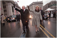 Vice President Dick Cheney and his wife, Lynne, wave to the crowds of people lining Pennsylvania Avenue as they participate in the Presidential Inaugural Parade January 20, 2001.