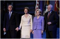"""President George W. Bush stands with Laura Bush, Lynne Cheney and Vice President Dick Cheney during the pre-inaugural event """"Saluting Those Who Serve"""" at the MCI Center in Washington, D.C., Tuesday Jan. 18, 2005."""