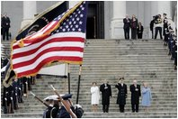 Escorted by Army Major General Galen Jackman, center, President George W. Bush, Laura Bush, Vice President Dick Cheney and Lynne Cheney salute the American flag from the U.S. Capitol steps before President Bush takes the oath of office for a second term as the 43rd President of the United States, Thursday, January 20, 2005.White House photo by Eric Draper
