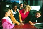 Lynne Cheney talks with 5th grade students Ashley Giorgio, left, and Anasha Segers, center, while they wait to take a seat on the Supreme Court Bench at the the National Constitution Center in Philadelphia Wednesday, Sept. 17, 2003.