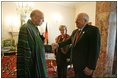Vice President Dick Cheney shakes hands with newly-elected President Hamid Karzai of Afghanistan before departing Kabul, Afghanistan, Dec. 7, 2004. Vice President Dick Cheney and Lynne Cheney flew to Afghanistan to attend the historic swearing-in ceremony of President Karzai.