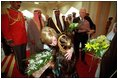 Two children greet Vice Present Dick Cheney and Mrs. Cheney with bouquets of flowers upon their arrival at Dasman Palace in Kuwait City, Kuwait, March 18.