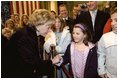 Lynne Cheney greets a young girl while visiting the U.S. Embassy in Rome Jan. 27, 2004. The visit concludes a five-day trip to Switzerland and Italy by Vice President Dick Cheney and Mrs. Cheney. White House photo by David Bohrer.