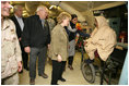 """Vice President Cheney and Mrs. Lynne Cheney visit the 212th M.A.S.H.(Mobile Army Surgical Hospital) Unit run by the U.S. military in a mountainous area near the earthquake's epicenter, 65 miles northwest of Islamabad, Pakistan, Tuesday Dec. 20, 2005. During the visit the Vice President said he was """"impressed with what we've been able to do with our M.A.S.H. units. U.S. forces were able to move quickly into the area. We were here within 48 hours and we've been here ever since."""""""