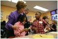 Laura Bush talks with Providence Family Support Center after-school program participants Isaiah Baynes, right, and Carlaija Whitehead during her visit and President Bush's to Pittsburgh to highlight the program's efforts to help area youth Monday, March 7, 2005.