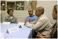 Laura Bush talks with, from left, Gabriel Flores, Archie Dominguez and Shirley Torres during a discussion at Homeboy Industries in Los Angeles April 27, 2005. Homeboys Industries is an job-training program that educates, trains and finds jobs for at-risk and gang-involved youth.