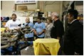 Laura Bush watches a silkscreen demonstration during a tour of Homeboy Industries in Los Angeles April 27, 2005.