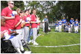 President George W. Bush hosts a White House Tee Ball (t-ball) game on the South Lawn between the Waynesboro, Virginia Little League Challenger Division Sand Gnats (Blue Team) vs. the East Brunswick, New Jersey Babe Ruth Buddy Ball League Sluggers (Red Team) September 22, 2002.
