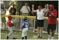 """Secretary of Education Margaret Spellings is on her toes as she declares safe at first Naji Loggins of the Newark (New Jersey) Black Yankees after Naji singled during """"Tee Ball on the South Lawn."""""""