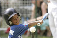 """Shaquana Smith of the Jackie Robinson South Ward Little League Black Yankees of Newark, N.J., swings at the ball Sunday, June 26, 2005, during """"Tee Ball on the South Lawn."""""""