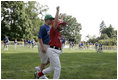 A player from the West University Little League Challengers from Houston, Texas cheers after scoring a run during a game on the South Lawn of the White House on Sunday July 24, 2005.