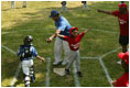 """Everyone's on the move as the Memphis Red Sox from Chicago score against the Black Yankees of Newark during """"Tee Ball on the South Lawn"""" Sunday, June 26, 2005."""