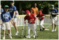 A player from the West University Little League Challengers from Houston, Texas, heads for homeplate to score a run, Sunday, July 24, 2005, during a Tee Ball game on the South Lawn of the White House.