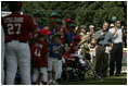 President George W. Bush welcomes players and their family members from the West University Little League Challengers from Houston, Texas, and the District 12 Little League Challengers from Williamsport, Pa., Sunday, July 24, 2005, at a Tee Ball game on the South Lawn of the White House.