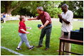 President George W. Bush hosts Tee Ball on the South Lawn with The Oriole Advocates Challengers of Marley Area Little League of Glen Burnie, Maryland and The Ridley Police Challengers of Leedom Little League, Ridley Park, Pennsylvania, July 27, 2003.