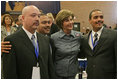 Laura Bush poses for photos with Homeboy Industries representatives, Gustavo Mojica, Herbert Corleto and Gabriel Hinojos, Thursday, Oct. 27, 2005 at Howard University in Washington, at the White House Conference on Helping America's Youth.