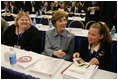 Laura Bush sits with Michaela Huberty, right, and her mentor, Jennifer Kalenborn, left, Thursday, Oct. 27, 2005 at Howard University in Washington, at the White House Conference on Helping America's Youth.