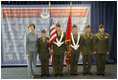 Laura Bush poses with the Young Marines Color Guard, Thursday, Oct. 27, 2005 at Howard University in Washington, during the White House Conference on Helping America's Youth.