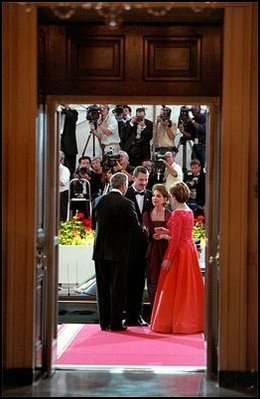 With cameras from the entire world watching, President George W. Bush and Mrs. Laura Bush greet Mexican President Vicente Fox and his wife Martha Sahagun de Fox to this administration's first State Dinner at the White House Sept. 5.