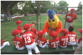 The San Diego Chicken visits the Rockies dugout before the game begins during a tee-ball game on the South Lawn May 6, 2001.